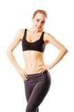 Sporty woman smiling into the camera Royalty Free Stock Photos