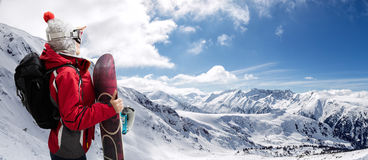 Sporty woman with snowboard Stock Images