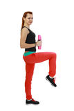 Sporty woman. Sport woman with pink barbells in hands performs fitness exercise. Side view isolated on white background Royalty Free Stock Image
