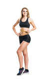Sporty woman in sportswear measuring her body isolated on white Royalty Free Stock Photos