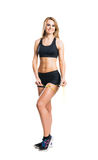 Sporty woman in sportswear measuring her body isolated on white Royalty Free Stock Photo