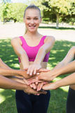 Sporty woman stacking hands with friends Stock Image
