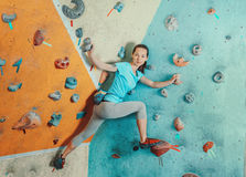 Sporty woman standing on artificial boulders Stock Photography