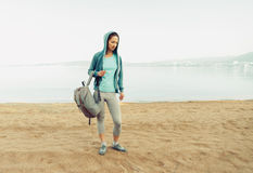 Sporty woman standing on beach Royalty Free Stock Photo