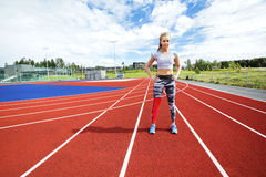Sporty Woman Standing With Hands on Hips at Running Tracks Stock Photo