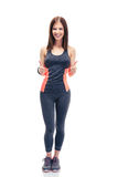 Sporty woman standing with thumbs up Royalty Free Stock Photos