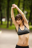 Sporty woman stretching arms before working out Stock Image