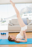 Sporty woman stretching body in fitness center Stock Images