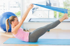 Sporty woman stretching body in fitness studio Stock Image