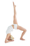 Sporty woman stretching body with raised leg Royalty Free Stock Photography