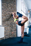 Sporty woman stretching at gym. Full length portrait of a sporty woman stretching at gym Stock Photo
