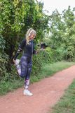 Sporty woman stretching her legs royalty free stock photos