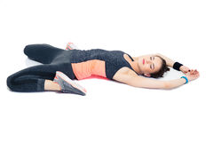Sporty woman stretching isolated on a white background Royalty Free Stock Images