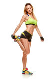 Sporty woman stretching legs Royalty Free Stock Image