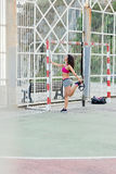 Sporty woman stretching legs before trx outdoor workout Royalty Free Stock Images