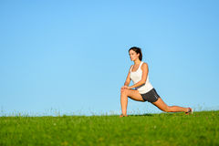 Sporty woman stretching outdoor Royalty Free Stock Photography