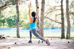 Sporty woman stretching in park Royalty Free Stock Photos