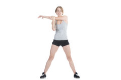 Sporty woman stretching shoulder blade Stock Photo