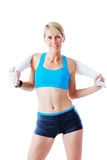 Sporty woman stretching a towel behind her back Stock Photos