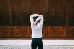 Sporty woman stretching triceps Royalty Free Stock Photos