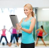 Sporty woman with tablet pc Stock Photo