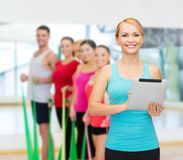 Sporty woman with tablet pc Royalty Free Stock Photography