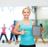 Sporty woman with tablet pc blank screen Stock Photo