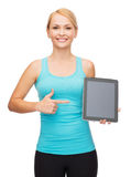 Sporty woman with tablet pc blank screen Stock Image