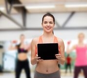 Sporty woman with tablet pc blank screen Stock Photos
