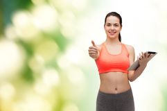 Sporty woman with tablet pc computer Stock Photography