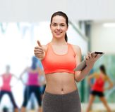 Sporty woman with tablet pc computer Royalty Free Stock Image