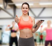 Sporty woman with tablet pc computer Royalty Free Stock Photos