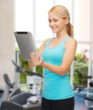 Sporty woman with tablet pc Stock Photos