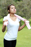 Sporty woman take a breath while stretching using towel Stock Photos