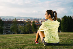Sporty woman taking a break after exercising Royalty Free Stock Photography