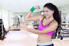 Sporty woman taking selfie photo at gym Stock Photo