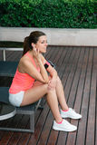 Sporty woman taking a workout rest Royalty Free Stock Photo