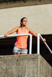 Sporty woman taking a workout rest Royalty Free Stock Photos