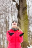 Sporty woman throwing snowball. Woman having fun throwing snowball. Relaxing in winter park wearing fashionable sporty outfit Stock Photos