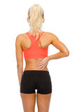 Sporty woman touching her back Royalty Free Stock Photography