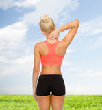 Sporty woman touching her neck Royalty Free Stock Images
