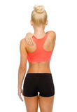 Sporty woman touching her shoulder Stock Image
