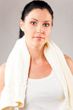 Sporty woman with towel Stock Image