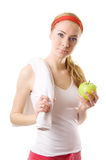 Sporty woman with towel and green apple Royalty Free Stock Images
