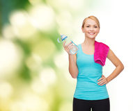 Sporty woman with towel and watel bottle Royalty Free Stock Images