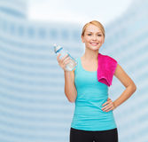 Sporty woman with towel and watel bottle Stock Photography