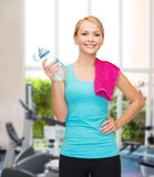 Sporty woman with towel and watel bottle Royalty Free Stock Photo