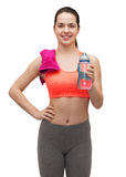 Sporty woman with towel and water bottle Stock Photography