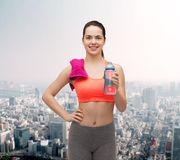 Sporty woman with towel and water bottle Royalty Free Stock Photo