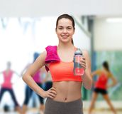 Sporty woman with towel and water bottle Royalty Free Stock Image